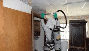 HEPA Vacuuming the top of a shelf